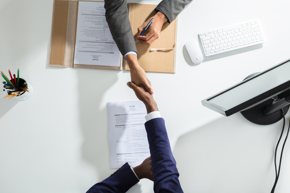 business people shaking hands in agreement | Convertibill®