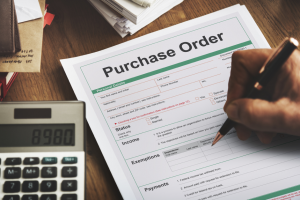 Business person filling out a purchase order. Convertibill® Finance